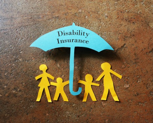 Paper family of four under a paper Disability Insurance umbrella